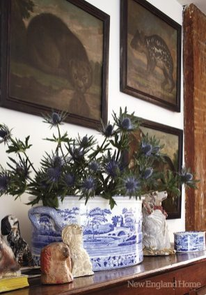 Paintings of mythical animals and nineteenth-century English transferware from an engaging tableau.