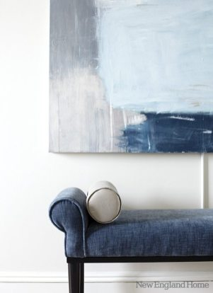 Accessories and upholstery take their cue from the hues in the living room's large abstract painting.