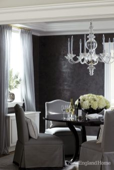 A round dining table softens the room's square shape.
