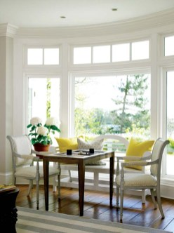 A sunny nook for playing backgammon commands a seaside view in the living room.