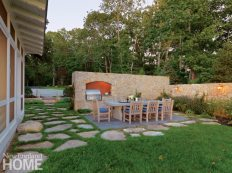 "A ""hidden garden"" made by CBA Landscape Architects for a home in Marion, Massa-chusetts, includes an outdoor grill and dining room enclosed by stone walls modeled on those of Tuscany"