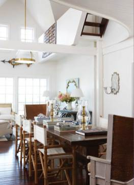 The eleven-foot-long dining table is headed by antique Orkney chairs and lined with old-fashioned bamboo director's chairs.