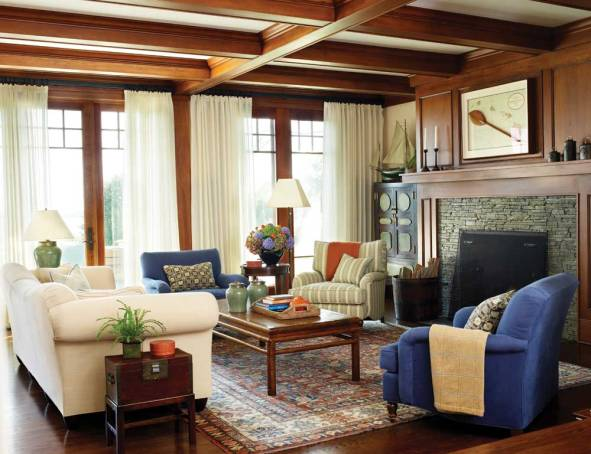 Designer Fotene Demoulas pulled blues, greens and creams from the living room rug in choosing drapery and upholstery fabrics.