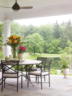 Porches, like this favorite spot for morning coffee, are deeper than the standard.