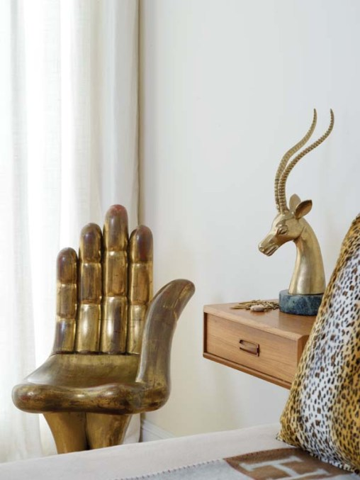 Pedro Freidberg's iconic Hand Chair occupies a bedroom corner.