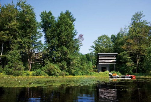 To preserve privacy the home is set back from the lake behind trees and even the small boathouse is tucked into a small, private cove.