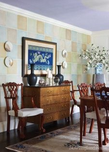 A lavender ceiling glows above a dining room designed with an eclectic mix of antiques and Midcentury pieces by Peter Robbin and Robin Jones of Lafalce, Campbell, Robbin.