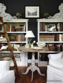 The bookcases were designed to hold the treasured pair of corbels.
