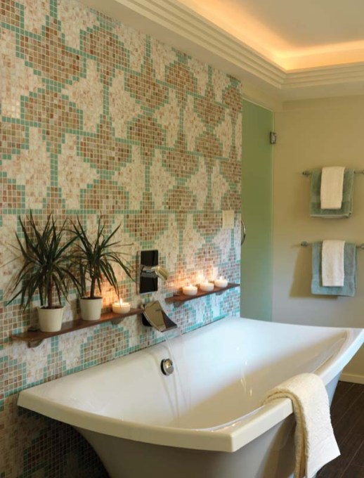 A wall of mosaic tile lends extra interest to the serene master bath