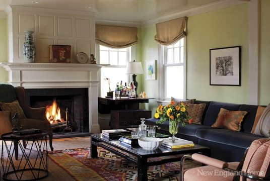 """This """"rambling New England cottage,"""" as Miller describes it, is as cozy as they come, especially with its four fireplaces aglow."""