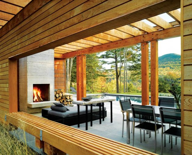 A cedar bench frames the open trellis area