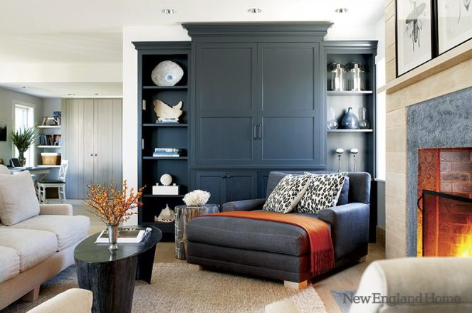 A handsome built-in armoire conceals the television.