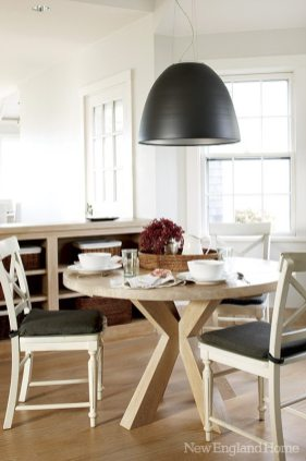An arresting two-foot-wide lamp spotlights the breakfast table.