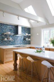 Scandinavian style kitchen with blue backsplash
