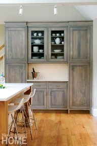 Kitchen bar area with rustic cabinetry designed by Mark Haddad