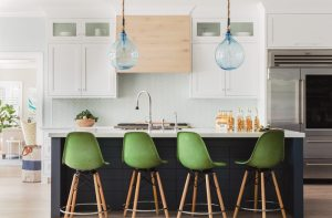 White kitchen with green stools