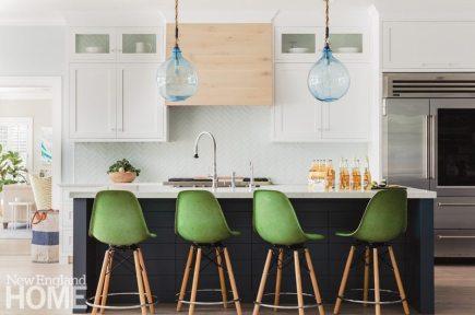 Contemporary white kitchen with black island
