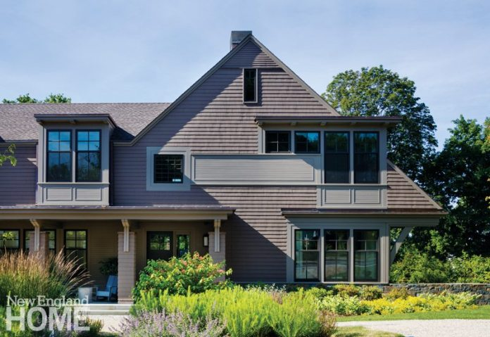 """Architect Paul MacNeely added modern tweaks, like the flat roofs on the dormers, to a traditional design. """"I'm just taking a different spin on a dormer,"""" he says. """"It makes them just a little more refined."""""""