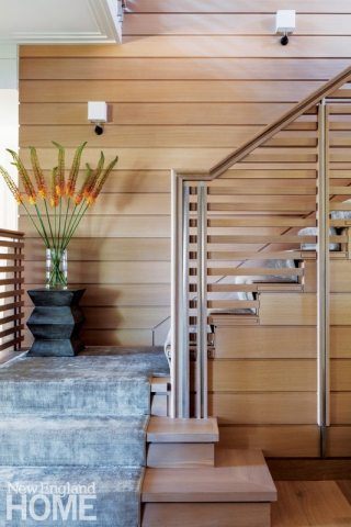 The main staircase is crafted in white oak with steel details—a design that demanded precision on the part of both architect and builder.