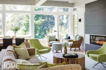 A wall of windows connects the family room to the backyard.