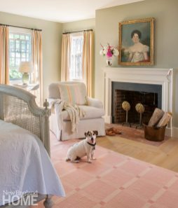 Sustainable Cape Cod Master Bedroom with Fireplace