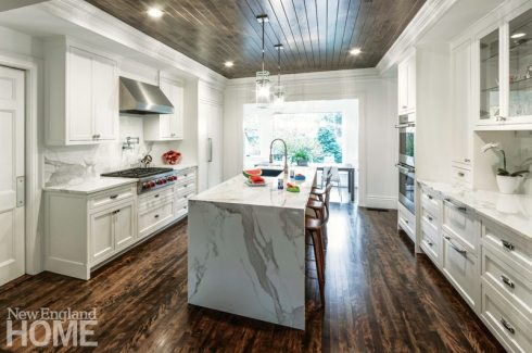 V-groove paneling adds special interest to the ceiling of a kitchen built by Cutting Edge Homes