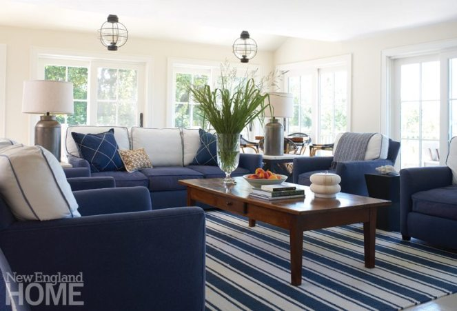 "A deft mix of antiques and contemporary pieces fosters a charming cottage ambience. ""The wife and I had a wonderful time sourcing pieces,"" says interior designer Linda Banks. ""Many of them are from local sources."" Holding court in the living room, the old cherry coffee table has a waxed finish reminiscent of a boat's deck."