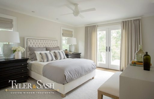 Neutral master bedroom with drapes and shades