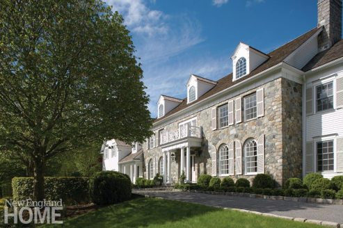 Less than two decades old, this classically designed colonial home in New Canaan offers no hint of the redesign from the front.