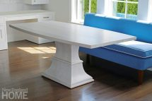Among Dwyer's most popular pieces is this pedestal table specifically designed to pair with a banquette.