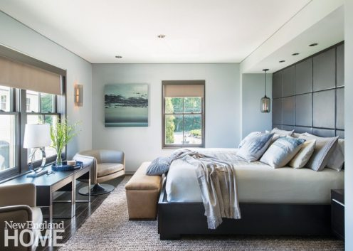 Pendant lights and leather panels behind the platform bed lend a masculine aspect the master bedroom.