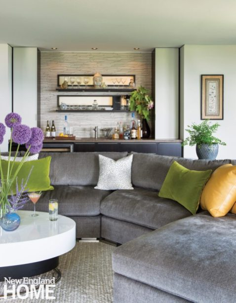 A cushy custom sectional sofa and an Asian-inspired wet bar encourage guests to linger.
