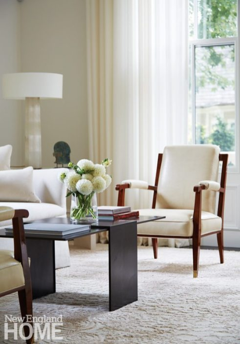 Contemporary Boston town home neutral living room wood and white upholstered chair