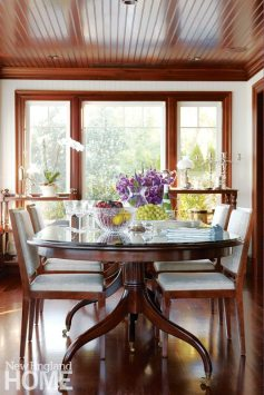 Although it's now used for dining, the old porch still retains its outdoorsy feel, with oversized windows that wrap the room in views.