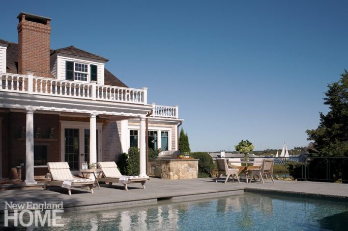 The pool, framed in bluestone and adjoining a new covered porch with an outdoor fireplace, also enjoys a harbor vista.