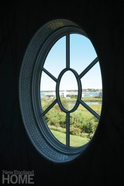 A round window offers views from the shower.