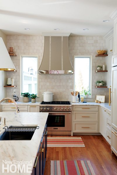 Elegant cream colored kitchen with walnut accents.