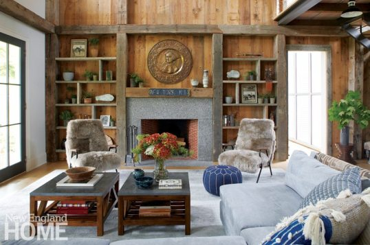 Reclaimed beams provide visual structure throughout the great room, but wood cladding was confined to one wall, so as not to appear overwhelming. room staircase captures the home's integration of old and new.