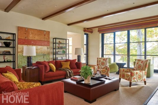 The colors of autumn suffuse the living room, from the Holly Hunt chairs and sofa to the A. Rudin armchairs and wall art.