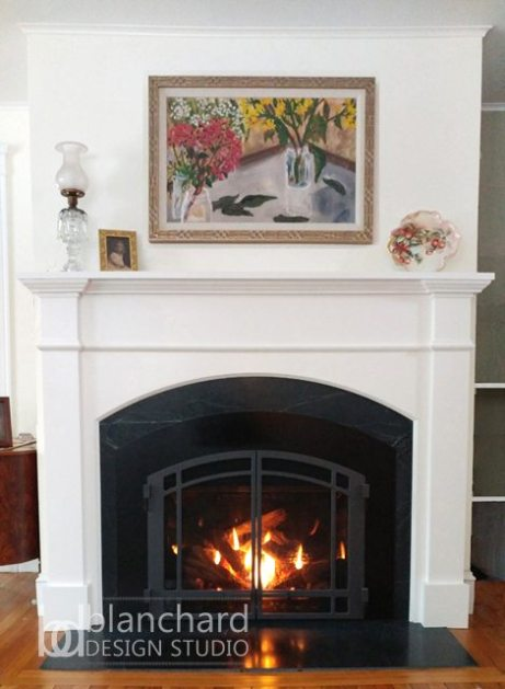 Blanchard Design Studio designed this new mantle to fit in with the home's original millwork.
