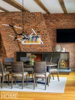 Contemporary dining room with exposed brick walls