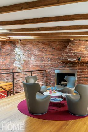 Contemporary seating area with fireplace and exposed brick wall