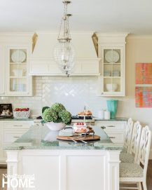"""""""Kate had her heart set on green kitchen countertops,"""" says Benedict, a hue that inspired the home's palette."""