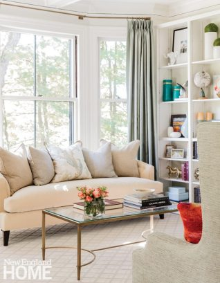 The Century sofa is a perfect fit for the living room's bay window—petite, curved, and plush.