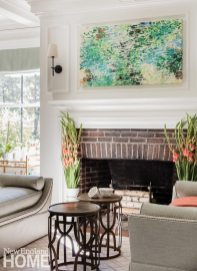 The owners fell in love with the work of Waltham, Massachusetts-based artist John Thompson and commissioned this painting for the space above the fireplace.