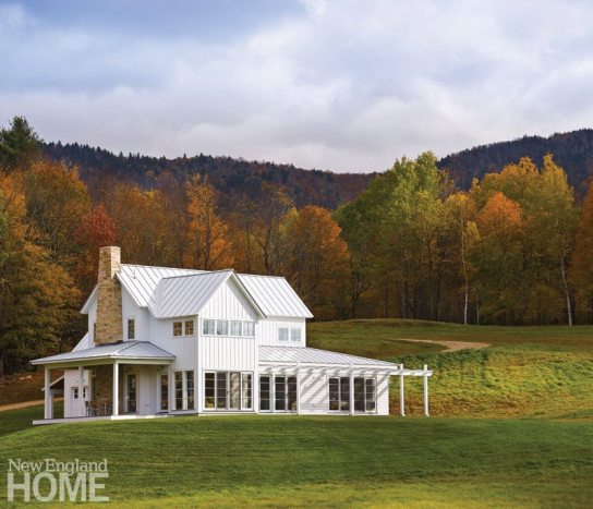 Set on a bucolic twenty-acre lot nestled into the Green Mountains, the three-bedroom contemporary home was inspired by traditional New England farmhouse design, but features a modern touch: walls of windows that invite the outside in and take full advantage of distant views.