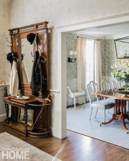 Neutral entryway with antique hall rack
