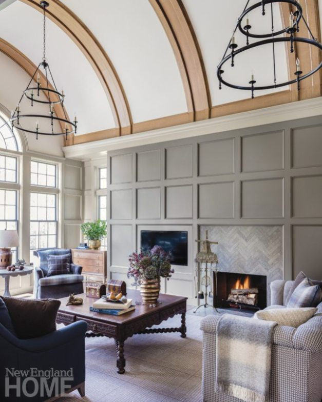Living room with custom panelling nhosting television and fireplace