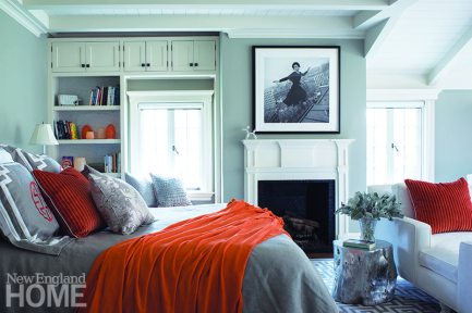 Neutral master bedroom with orange accents