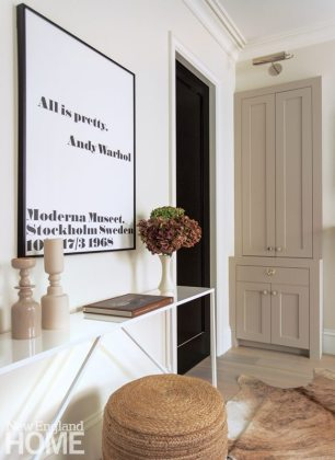 White console with contemporary artwork